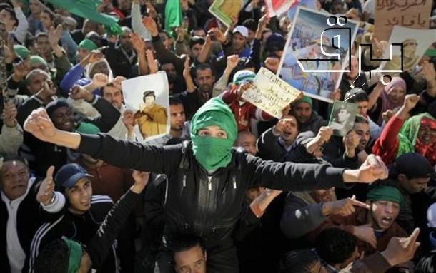Gadafistas celebran los éxitos del Ejército gubernamental el domingo 6 de marzo de 2011 en la mítica Plaza Verde de Trípoli | Fuente: BRQ Network/Ben Curtis